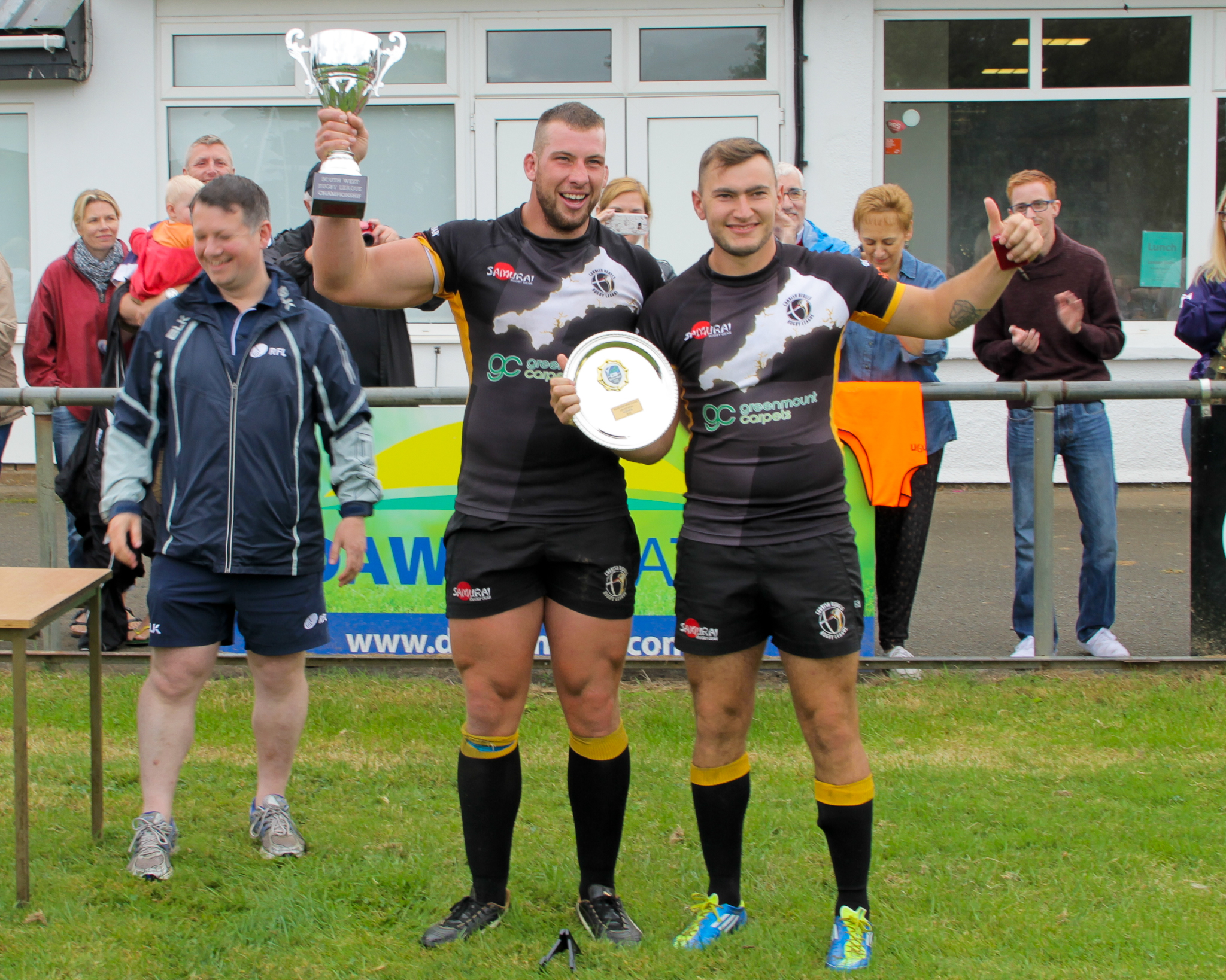 Jack Scott and Liam Freeman collect the Trophy from RFL Competition Manager Chris Chatten