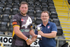 Captain Jamie Prisk recieves the South West Cup from the RFL's Marc Lovering