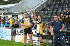 Jamie Prisk & Darren Pellow lift the trophy!