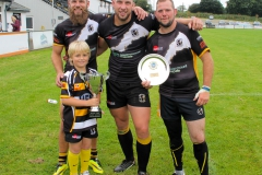 Jodi Briskham Jack Scott and Matt Ballard share the Trophy with Rebels Ball Boy Ewan Simpson age 10
