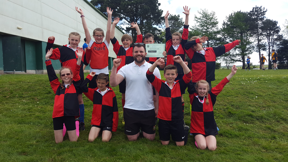 Mr Marriott and his winning Tregony team celebrate winning the festival