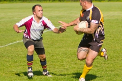Ashley Lawton fends off a Somerset Viking defender